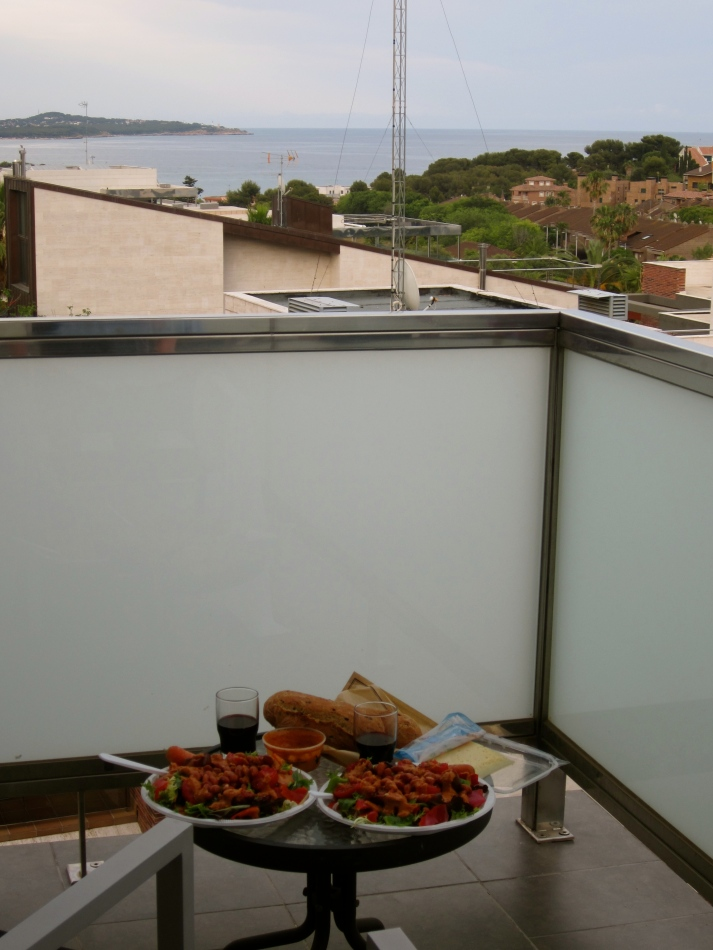 'Homemade Dinner with a View'. Many nights we bought some veggies and ate a salad on our hotel balcony.